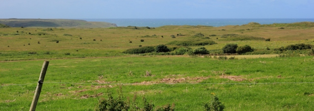 view over Castlemartin artillery range, Ruth walking in Pembrokeshire
