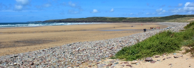 Ruth Livingstone walking across Freshwater West