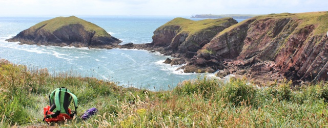 Sheep Island and St Ann's Head, Ruth walking the Pembrokeshire Coast Path
