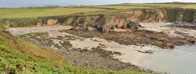 Porthlysgi Bay, Ruth hiking the Pembrokeshire Coast