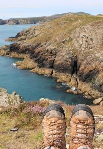 lunch break, Ruth on Pembrokeshire Coast Path