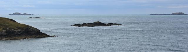Kayaker off Whitesands Bay, Ruth hiking coast Path, St Davids