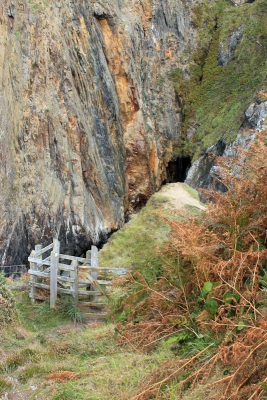 plunge to waterfall at Pwllcrochan, Ruth walking the coast path in Pembrokeshire