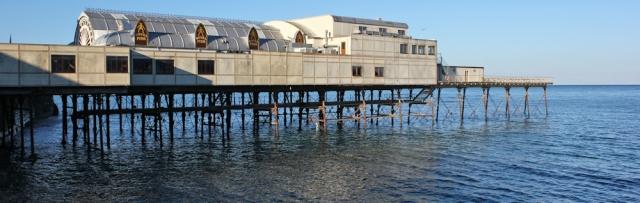 03 sad pier, Aberystwyth, Ruth trekking on the Ceredigion Coast Path