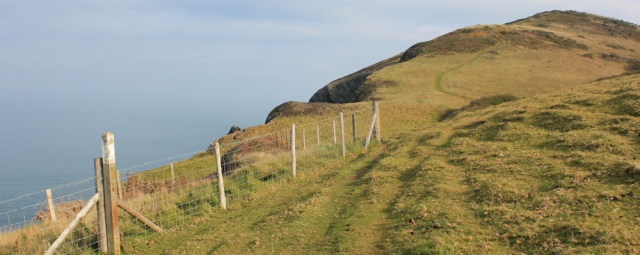 03 steep climb up cliffs, Ruth walking the Ceredigion Coast Path, Llanrhystud