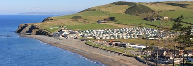 10 caravans at Clarach Bay, Ruth walking to Borth, Wales