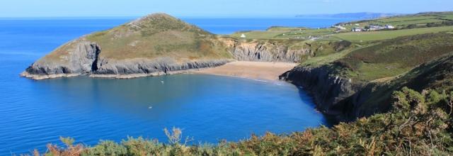 12 Beach at Mwnt, Ruth hiking the Ceredigion Coast