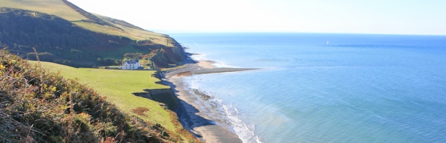 12 looking back to Wallog and Sarn Gynfelyn, Ruth Livingstone hiking the Wales coast