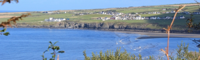 17 looking across to Gwbert, Ruth walking the Pembrokeshire Coast Path
