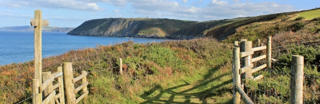 18 evening light. Ruth walking the Wales coast, Cardigan Bay