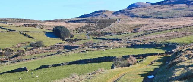 05 farm tracks above Fairbourne, Ruth walking the Wales Coast Path