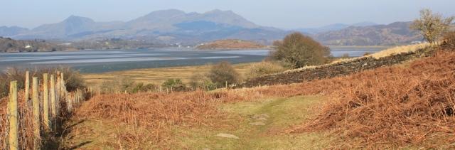 19 heading up the Afon Dwyryd estuary, Ruth on the Wales Coast Path