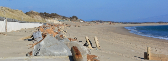 21 sea defences, Ruth walking the beach, Pwllheli