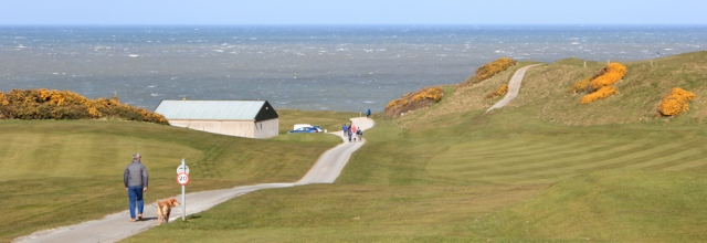 01 Nefyn golf course, Ruth walking the coast, Pen Llyn, Wales