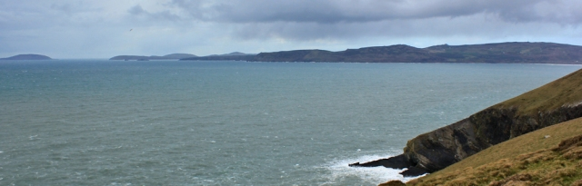 13 looking across Porth Neigwl, Ruth walking the Llyn Coastal Path