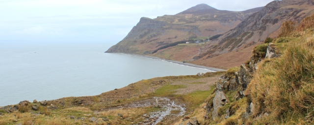 13 overlooking Porth y Nant, Ruth walking the Llyn coast path