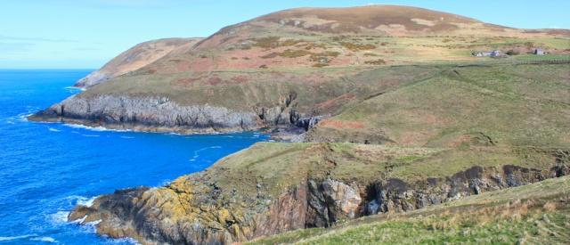 17 Looking towards Mynydd Anelog, Ruth walking in Wales