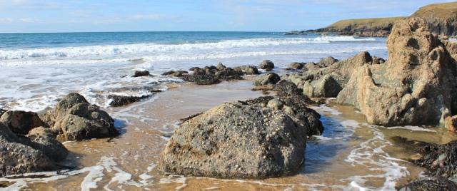 20 end of Porthor Beach, Ruth walking the Llyn Peninsula