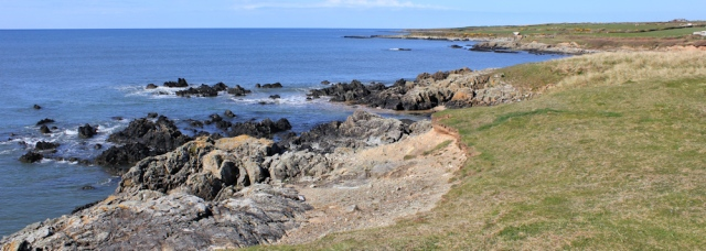 04 rocky coast, Ruth walking the coastline, Aberffraw Bay, Anglesey