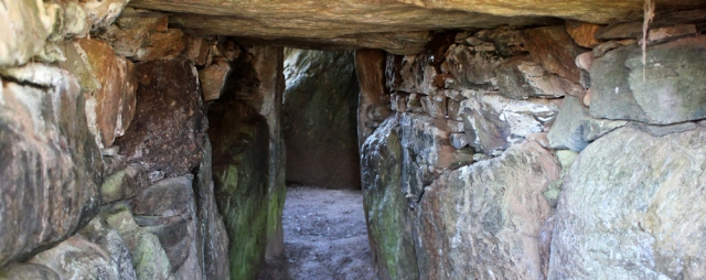 07 inside cairn chamber, Ruth in Brycelli Ddu, Anglesey