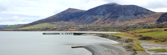 07 Trefor Pier, Ruth walking along the Wales Coast path