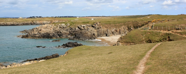 12 Porth Tarfyn and Porth Trecastell, Ruth hiking the coast, Anglesey