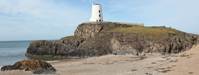 13 Llanddwyn Island Lighthouse, Ruth walking the coast
