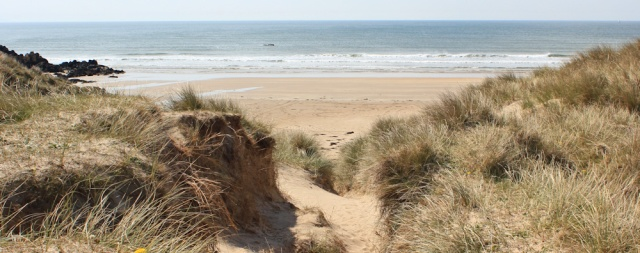 17 Aberffraw Sands, Ruth walking the Isle of Anglesey coastal path