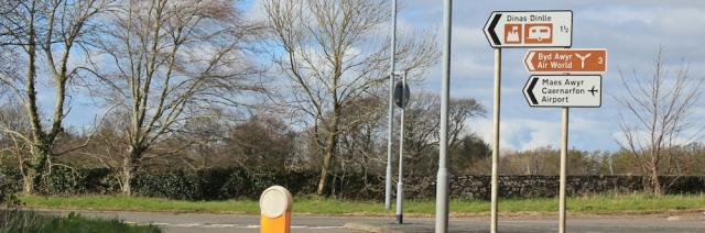 19 sign to Caernarfon airport, Ruth walking the Wales Coastal Path