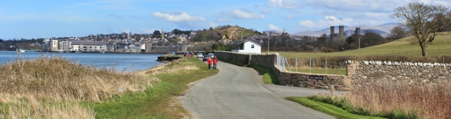 approaching Caernarfon, Ruth walking the Wales Coast Path