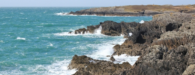 a03 rugged coastline, Ruth walking towards Borthwen, Anglesey