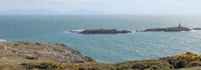 a16 view over Rhoscolyn Beacon and Llyn Peninsula, Ruth trekking in Wales