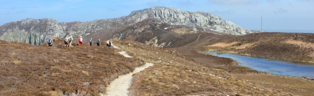 17 Holyhead Mountain, Ruth hiking the Isle of Anglesey coast path
