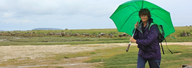 04 walking with an umbrella, Wales Coast Path, Ruth Livingstone
