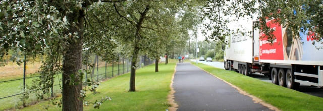 08 Ruth walking through the Deeside Industrial Park