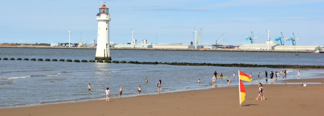 17 New Brighton beach and lighthouse, Ruth hiking the Wirral coastline
