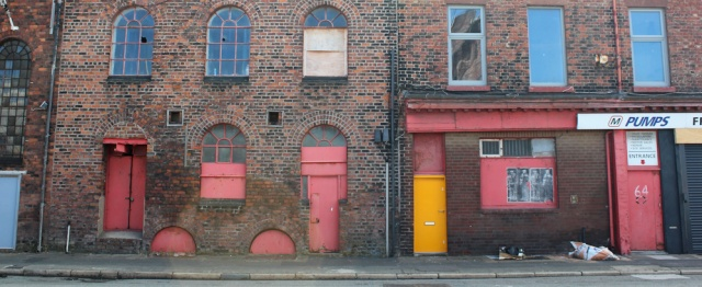 17 old warehouses, Ruth walking through Bootle, Liverpool Docks