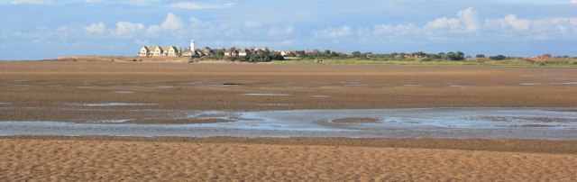 a07 view across to Hilbre Point, Ruth hiking the Wirral