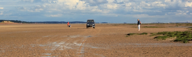 a08 driving across the sands, Ruth hiking to Hilbre Island