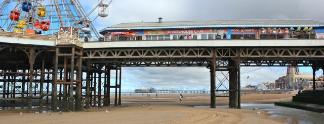 09-under-central-pier-ruth-walking-blackpool-beach