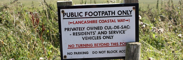 39 signs everywhere, Ruth walking the Lancashire Coastal Path