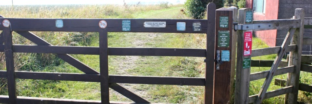 41 signs on the gate, Warton Bank, Ruth Livingstone trying to walk the coast