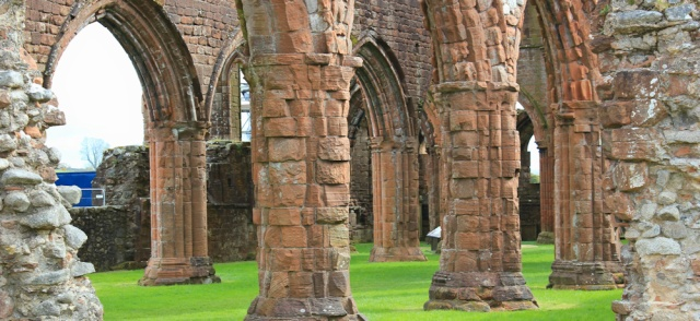 02 arches inside Sweetheart Abbey, Ruth walking in Dumfries and Galloway