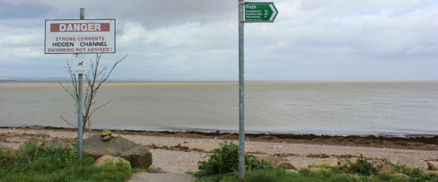 24 signs on Carsethorn Beach, Ruth walking in Dumfries and Galloway