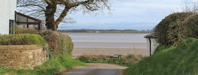 30 coast at Whinnyrig, Ruth walking the shore to Annan