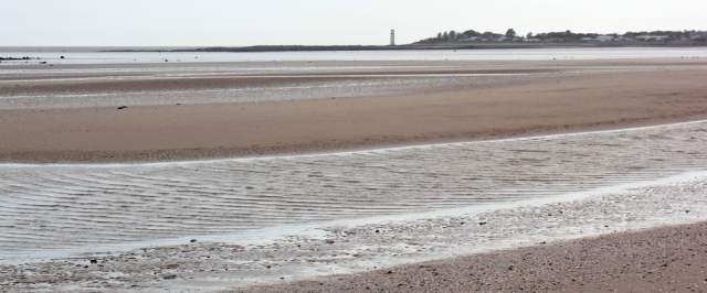 39 Southerness lighthouse across Gillfoot Bay, Ruth walking in Dumfries and Galloway