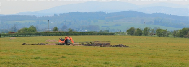 06 digger in field, Ruth hiking to Wigtown, The Machars, Scotland