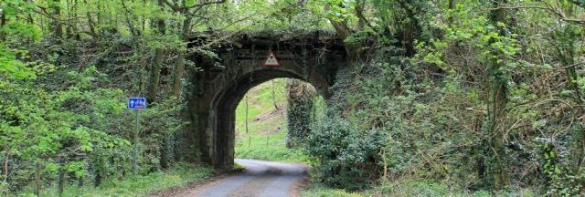 06 under old railway bridge, Ruth hiking to Garlieston