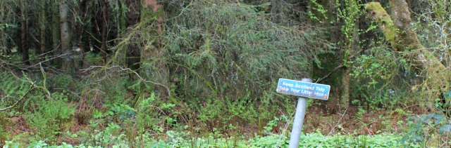 10 litter sign, Ruth hiking to Wigtown, The Machars, Scotland