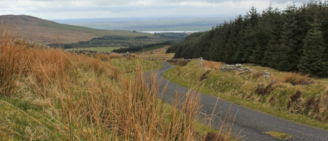 20 top of climb, Cambret Hill, Ruth hiking along Slakes Road, Dumfries and Galloway